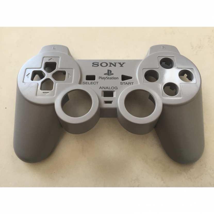 Plasturgie supérieur coque pièce détachée de manette de console de jeu de marque Sony type Playstation référence SCPH-1200